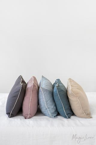 Linen pillowcase with ivory pom-poms